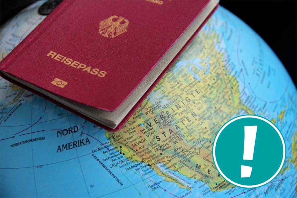 Reisepass liegt auf Globus